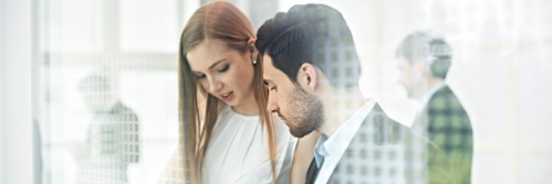 Business woman and man evaluating ap automation solution
